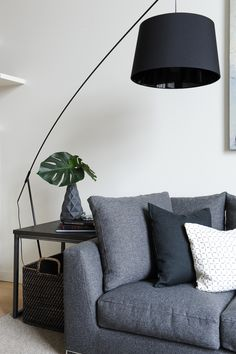 Grey living room design with black over hanging life | Shift Interiors