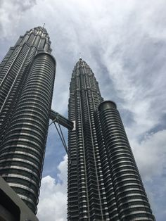Petronas Twin Towers in Kuala Lumpur, Malaysia, are a sight to see! Pictures do not do them justice. Malaysia Travel, Malaysia Trip, Kuala Lampur, Two Rivers, Amazing Buildings, View Video, Vacation Pictures, Burj Khalifa, World Traveler