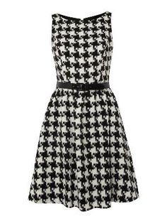 Perfect for Lizzie ! <3 Houndstooth. this with a pop o color... lime green belt/tights?.... so love