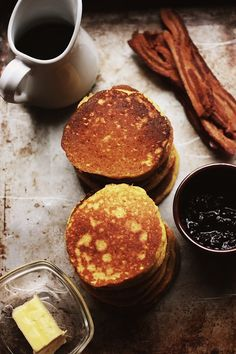 Honey, Buttermilk and Cornmeal Pancakes  prep time: 5 minutes  cook time: 20 minutes  yields: 16 4-inch pancakes    Ingredients    1 1/2 cups cornmeal  1/2 cup whole-wheat flour  1 1/2 teaspoons baking powder  1/4 teaspoon baking soda  3/4 teaspoon salt  1 2/3 cups buttermilk  1/4 cup honey (I've also used molasses here, for a deeper flavor)  2 eggs  3 Tablespoons melted butter