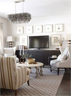 Great tv console idea by sarah richardson-- she used kitchen cabinets (IKEA, I think) and gained horizontal storage