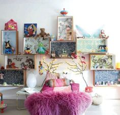 Small, simple wood wall shelves whose rear walls were papered with brightly patterned wallpaper. Via First Home.