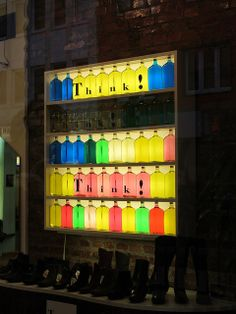 Backlit display with recycled bottles filled with colored water?  Black letter stickers to make a message?