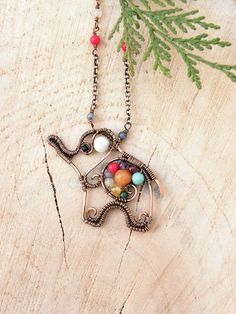 Hey, I found this really awesome Etsy listing at https://www.etsy.com/listing/163185824/elephant-necklace-wire-wraped-animal