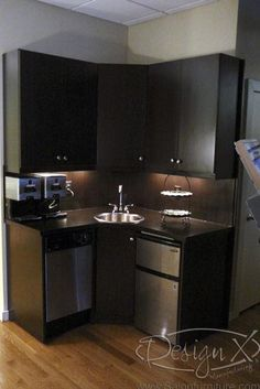 Like the cabinet color and a good idea for a coffee centre or small kitchen, bedsit