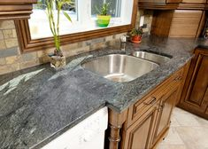 Soapstone countertops with a hole for conventional sink