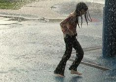 Running barefoot in the rain...looks like me as a child(-: