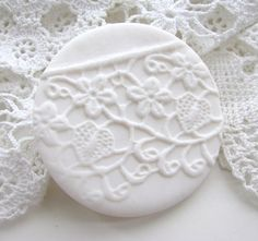 """Ioana Weber from Rotterdam quiets the week with her White Noise series of polymer brooches. This Dutch mixed media artist had been collecting vintage laces and looking for a way to use them in a project. """"Some are so delicate and old, it's almost impossible to make something with them,"""" she explains."""