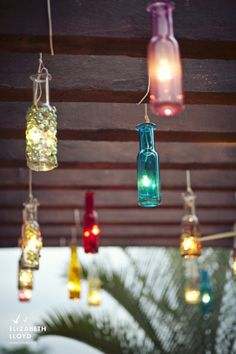 Candlelit bottles hanging from the ceiling above the dance floor - gorgeous! Beach wedding,  papel picado ,  Mexican wedding ,  vintage Mexican wedding ,