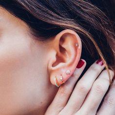 Ear candy secrets by @brokenenglishjewelry. Featured jewelry: Diamond Trinity stud (helix), Flower Stud (3rd earlobe), Princess Diamond ring