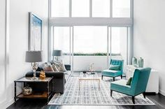 Beautiful Design for your Living Room with Turquoise Blue Chairs.  Get Latest Design and Decor Ideas & Tips for your Home at http://www.constructionmarkets.com/decor