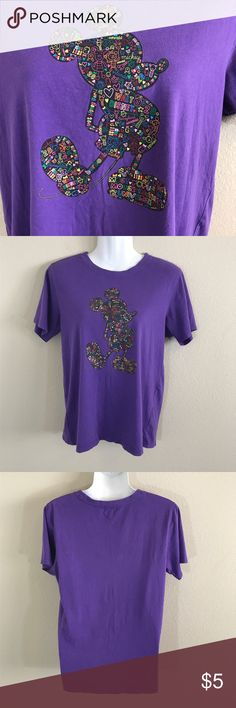 Disney Purple Collection T-shirt  (14-15) Junior Disney Purple Collection by Hang Ten T-shirt size 14-15( women size small). Pre-Owned. Gently used with no flaws. Has a print of Mickey Mouse with logos inside the large print. Look at pictures for more details.  Stored in a smoke-free/pet-free environment. Disney Tops Tees - Short Sleeve