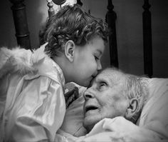 The Kiss of a Child Angel.I love this. I like to think that my inner child angel kissed my grandfather goodbye like this for me. We never saw each other but through such an angel I like to think my love was passed on. Love Is All, True Love, Angels Among Us, Jolie Photo, People Of The World, Black And White Photography, Bellisima, Alter, Decir No