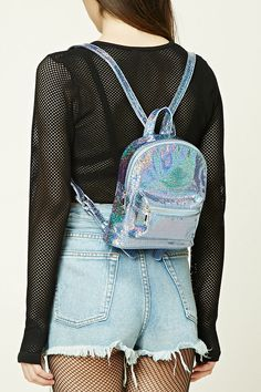 319d74e02543 A faux leather structured mini backpack featuring an allover glitter  pattern