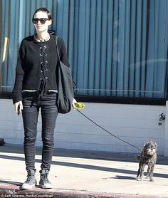 Enjoying the sunshine? Rooney Mara didn't look especially pleased when she stepped out with her small dog on Saturday in Los Angeles
