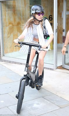 Cara Delevingne on her battery-powered bike