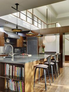 This Venice kitchen by Jamie Bush & Co (interior design) and Marmol Radziner (architecture) is the central focus of the house, which features a double-story atrium space.