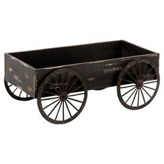 Perfect for showcasing your favorite potted plants or herbs, this charming wood cart decor showcases a warmly weathered finish and wagon-sty...