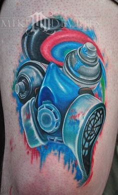 Above: This graffiti tattoo depicts both a spraycan and a gas mask ...