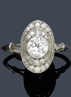 A BELLE EPOQUE DIAMOND RING, CIRCA 1910. Platinum. Decorative ring centring an old European-cut diamond, and set throughout with 24 single-cut diamonds. #BelleÉpoque #ring