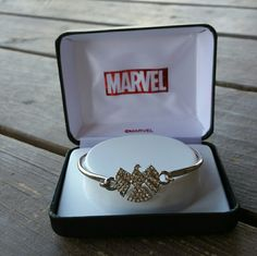 Marvel's Bracelet Agents of Sheild Show off your support of Marvel's Agents of SHIELD and wear the Agents of SHIELD Logo Bling Gems Bracelet with pride. This beautiful bracelet is made of stainless steel and features clear cubic zirconia gems on the logo. Ages 13 and up.   Limited Supply.  Comes in Branded Case. Marvel Jewelry Bracelets