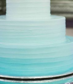 An ombre wedding cake in aquatic colors. Love this for a beach wedding! {Katelyn Marie Photography}