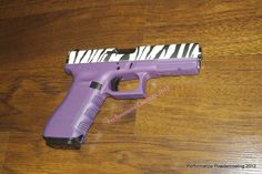 This is my Glock 22 .40cal - SUPER GIRLY with Zebra Hydrographics and Purple Cerakote