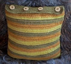 Needlebound / nalbound pillow made using two-ply weave yarn (that has been dyed with hazel for bright orange, dyer's weed for yellow, and St Johns Wort for green, as well as buttons made from ash tree) and trial and error stitch ;), by Jannika Boström. Posted 2015-11-09 in Nålbindning group on facebook. Please see source link for original post!