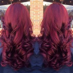 Nice purple-red hair color with wavy hair style