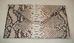 Bolso de mano hecho con piel de imitación de Pitón