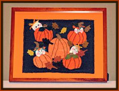 """Several years ago I was working on creating wool felt penny rug pictures for my """"It's Raining Baby Showers"""" baby shower decorations line and thought that little baby heads coming out of pumpkins or wearing pumpkin tops as hats would be cute.  They'd all be hiding in the pumpkin patch waiting to be found. So, my """"Babies In The Pumpkin Patch"""" design was born..... Rain Baby Showers, Baby Shower Pictures, Felt Pictures, Stitch Pictures, Patch Design, Baby In Pumpkin, Blanket Stitch, Doll Maker, Love Is Free"""