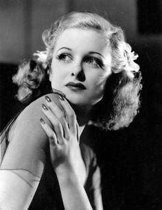 Joan Bennett. Hair, makeup and nail perfection.