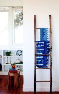 A perfect spot for a blanket ladder separates the entry from this little nook in the living room. The top textile is from Block Shop and the bottom a Tensira piece from Shoppe Amber. The two books on the stool are English-Russian dictionaries found at a local thrift shop.