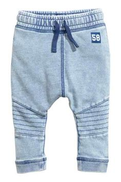 Blue washed out. Joggers in soft, washed sweatshirt fabric. Elasticized drawstring waistband, contrasting back pocket, and dropped gusset. Tapered legs with Baby Outfits, Newborn Outfits, Denim Jogger Pants, Boys Joggers, Baby Girl Pants, Baby Jeans, Gender Neutral Baby Clothes, Kids Pants, Kids Fashion Boy