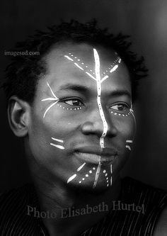 Young african man with face painting, portrait black and white