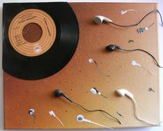 The beginning of a musical life... Funny thought, digital earbuds heading towards a 45 rpm single.