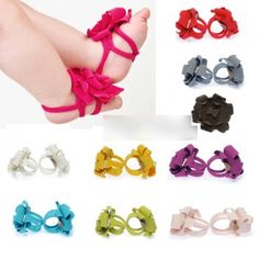 Baby barefoot sandals, barefoot booties, toe blooms, crib shoes, foot jewelry, flower sandals... whatever you want to call them, they're adorable, and this site actually has them in every color for only $6.99 a pair with reasonable shipping. :-)
