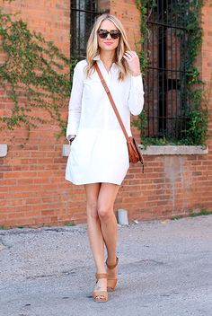 Your Guide To Wearing Neutral Colors This Spring: Fashion blogger 'Fashion Jackson' wearing a white shirt dress, brown wedges, brown sunglasses and a brown saddle bag.