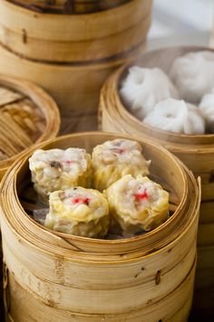 SIU MAI Dumplings with a pork-based filling and an open top, often with an orange or pink dot at the center - photo only