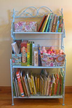 | hobby lobby bakers shelf turned into chic little girls room bookshelf! |