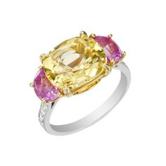 Paolo Costagli Yellow Sapphire & Pink Sapphire Ring  Cushion-shaped yellow sapphire in 18k white gold with an 18k yellow gold basket, accented by half moon shaped pink sapphire shoulders and shanks partway set with round-cut diamonds. Yellow sapphire weighing 4.98 carats, two pink sapphires weighing 1.35 total carats and diamonds weighing 0.16 total carats. Handmade in New York City. Designed by Paolo Costagli. Size 6.5.        Price: $19,000
