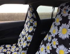 Cute... not sure if they'd fit and might be a bit too much! ha ha! Like them though! Airbag-friendly Car Seat Covers: White Daisy in the Black from Me-Mo - Funky Car Accessories for Girls. Great Gift Ideas!