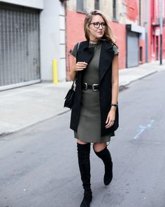 This outfit gave me the idea to wear my black long vest, olive green sleeveless dress, and black faux suede lace-up knee boots.