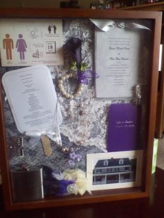 Our wedding shadow box that I made to preserve some of the momentos from our wedding. I included our save the date, invitation, fans from the ceremony, lace from my dress, my veil, hair piece, and jewelry (my mother made my hair piece and veil), my husband's boutineer and flask, a couple of flowers from my bouquet, and a photo of our wedding venue.