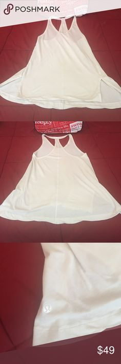 Super rare White Lululemon tank Like new condition no rips or tears stains or pilling . This is a size 4 but can easily fit a 6 . Soft and flowing material feels like cotton on your skin. Stretches easily so you can pull it and tie it up in a knot in the back for a super cute alternate look. Comes from a non-smoking Vegan home lululemon athletica Tops Tank Tops