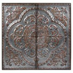 """Tile-inspired metal wall decor.  Product: Wall decorConstruction Material: MetalColor: Silver and bronzeDimensions: 36"""" H x 36"""" W x 1.5"""" D"""
