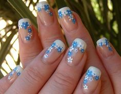 french manicure with white and blue flowers