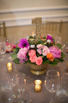 Centerpiece with a gold glitter table number | A Fun & Sophisticated DC Wedding via TheELD.com
