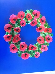 ANZAC wreath . Cupcake wrappers and button for poppies. Curled green paper.
