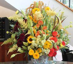 Hillwood Estate Museum Visitor Center arrangement includes: Amaranthus, Celosia, Dahlias, Sunflowers, Cramers okrazilla, Asclepias physocarpus, Nandina and Eucalyptus Cinerea.